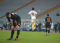 Real Madrid's Luis Figo celebrates toward the away bench after scoring the 3rd goal in a 0-3 win in an empty Stadio Olympico. Fans were banned after the referee was hit by a missle during a previous Champion's League match.