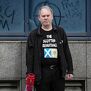 Sean Clerkin of the Scottish Resistance at a demo in Glasgow. Picture Robert Perry 29th Jan 2016<br /> <br /> Must credit photo to Robert Perry<br /> FEE PAYABLE FOR REPRO USE<br /> FEE PAYABLE FOR ALL INTERNET USE<br /> www.robertperry.co.uk<br /> NB -This image is not to be distributed without the prior consent of the copyright holder.<br /> in using this image you agree to abide by terms and conditions as stated in this caption.<br /> All monies payable to Robert Perry<br /> <br /> (PLEASE DO NOT REMOVE THIS CAPTION)<br /> This image is intended for Editorial use (e.g. news). Any commercial or promotional use requires additional clearance. <br /> Copyright 2014 All rights protected.<br /> first use only<br /> contact details<br /> Robert Perry     <br /> 07702 631 477<br /> robertperryphotos@gmail.com<br /> no internet usage without prior consent.         <br /> Robert Perry reserves the right to pursue unauthorised use of this image . If you violate my intellectual property you may be liable for  damages, loss of income, and profits you derive from the use of this image.