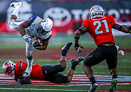 Utah State Aggies running back LaJuan Hunt (21), top left, jumps in the air as he falls after running the ball against the UNLV Rebels during the fourth quarter of a football game at Sam Boyd Stadium in Las Vegas, Saturday, Oct. 21, 2017. Utah State Aggies won 52-28. (Joel Angel Juárez / Las Vegas Review-Journal)