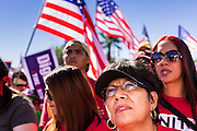 05 OCTOBER 2013 - PHOENIX, ARIZONA:   A woman listens to speakers at an immigration reform rally in Phoenix. More than 1,000 people marched through downtown Phoenix Saturday to demonstrate for the DREAM Act and immigration reform. It was a part of the National Day of Dignity and Respect organized by the Action Network.   PHOTO BY JACK KURTZ