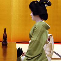 Asia, Japan, Kyoto. A sitting Geisha in profile.