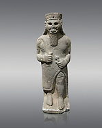 Hittite baslat sculptute of a male, late Hittite Period - 900-700 BC. Adana Archaeology Museum, Turkey. Against a grey background .<br /> <br /> If you prefer to buy from our ALAMY STOCK LIBRARY page at https://www.alamy.com/portfolio/paul-williams-funkystock/hittite-art-antiquities.html . Type - Adana - in LOWER SEARCH WITHIN GALLERY box. Refine search by adding background colour, place, museum etc.<br /> <br /> Visit our HITTITE PHOTO COLLECTIONS for more photos to download or buy as wall art prints https://funkystock.photoshelter.com/gallery-collection/The-Hittites-Art-Artefacts-Antiquities-Historic-Sites-Pictures-Images-of/C0000NUBSMhSc3Oo