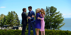 President of France Emmanuel Macron, left, and wife Brigitte Macron, second right, are greeted by Prime Minister Justin Trudeau and wife Sophie Gregoire-Trudeau during the official welcoming ceremony at the G7 Leaders Summit in La Malbaie, Quebec, Canada on Friday, June 8, 2018. Photo by Sean Kilpatrick/CP/ABACAPRESS.COM