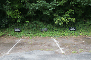 Golf club parking spaces for the club captains in Axmouth, Devon, England, United Kingdom.