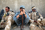 Mcc0018106 . SundayTelegraph..For the Sunday Telegraph..Soldiers from 2 Yorks taking a rest in local Police compound whilst out on patrol  in Nad e'Ali , the district in Helmand province where last week 5 soldiers were killed by a rogue Afghan policeman.....Afghanistan 7 November 09