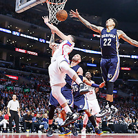12 April 2016: Los Angeles Clippers guard Austin Rivers (25) is fouled as he goes for the reverse layup past Los Angeles Clippers forward Branden Dawson (22) during the Los Angeles Clippers 110-84 victory over the Memphis Grizzlies, at the Staples Center, Los Angeles, California, USA.