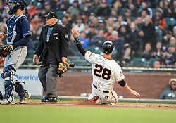 April 30, 2018 - San Francisco, CA, U.S. - SAN FRANCISCO, CA - APRIL 30: San Francisco Giants Catcher Buster Posey (28) slides into home plate during the San Francisco Giants and San Diego Padres game on April 30, 2018 at AT&T Park in San Francisco, CA. (Photo by Stephen Hopson/Icon Sportswire) (Credit Image: © Stephen Hopson/Icon SMI via ZUMA Press)