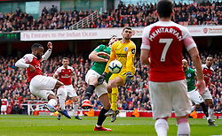 Arsenal's Alexandre Lacazette has a shot on goal saved by Brighton & Hove Albion goalkeeper Mathew Ryan during the Premier League match at the Emirates Stadium, London.