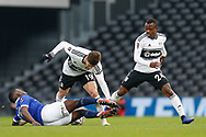 Oldham Athletic midfielder Christopher Missilou (17) tackles Fulham forward Luciano Vietto (19) during The FA Cup 3rd round match between Fulham and Oldham Athletic at Craven Cottage, London, England on 6 January 2019.