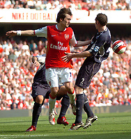 Photo: Tony Oudot.<br /> Arsenal v Bolton Wanderers. The Barclays Premiership. 14/04/2007.<br /> Tomas Rosicky of Arsenal fights for the ball with Nicky Hunt of Bolton