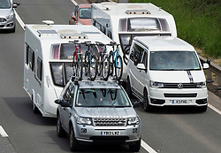 © Licensed to London News Pictures; 29/05/2021; Bristol, UK. Heavy traffic with caravans, camper vans and motor homes is seen passing Bristol on the M5 southbound on the late May bank holiday weekend during the covid coronavirus pandemic as restrictions have been eased to allow travel and staycations in England and Wales. The weather is forecast for this weekend to have the hottest day of the year so far. Photo credit: Simon Chapman/LNP.