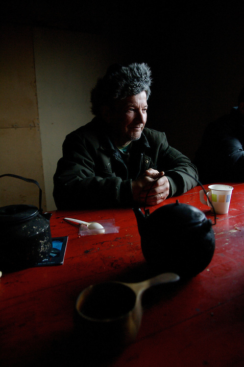 A Sami Reindeer Herder enjoys coffee on a frosty autumn morning before undertaking the first reindeer roundup of the year.