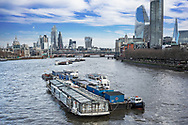 The commercial area known as the City of London seen from the River Thames.