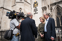 © Licensed to London News Pictures. 20/06/2017. London, UK. Actress JULIET STEVENSON (second from right) and Lord ALF DUBS (right), both pro-refugee campaigners, speak with the media outside the Royal Courts of Justice. Refugee charities have today taken the British government to court in an attempt to force the Home Office to reopen the Dubs Amendment scheme which enabled the transfer of unaccompanied refugee children from Europe to the United Kingdom. The scheme was expected to facilitate the transfer of 3,000 child refugees but was shut down by the Home Office after approximately 350. Photo credit: Rob Pinney/LNP