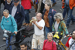 October 3, 2018 - Mannheim, Baden-Württemberg, Germany - A protester plays the Ode to Joy, the Anthem of Europe, on a trumpet. Over 9.000 people marched through Mannheim on the Day of German Unity under the slogan for democracy, humanity and rule of law. The protesters demonstrated for human dignity and a peaceful coexistence in Mannheim and against the emerging racist and xenophobic tendencies in Germany. (Credit Image: © Michael Debets/Pacific Press via ZUMA Wire)