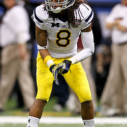 January 3, 2012; New Orleans, LA, USA; Michigan Wolverines cornerback J.T. Floyd (8) against the Virginia Tech Hokies during the Sugar Bowl at the Mercedes-Benz Superdome. Michigan defeated Virginia 23-20 in overtime. Mandatory Credit: Derick E. Hingle-US PRESSWIRE