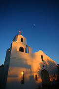 """SHOT 12/18/2007 - The Old Adobe Mission in Old Town Scottsdale catches some of the last rays of light as the sun sets one afternoon. Scottsdale, Az. is a city in Maricopa County, Arizona, United States, adjacent to Phoenix. Scottsdale has become internationally recognized as a premier and posh tourist destination, while maintaining its own identity and culture as """"The West's Most Western Town."""" What had, in the twentieth century been vacant desert, was converted to urban or suburban environment. The 2000 Census found the city's population to be 202,705, while according to the 2007 Census Bureau estimates, the population of the city was 240,410. Includes images of Old Town Scottsdale..(Photo by Marc Piscotty/ © 2007)"""