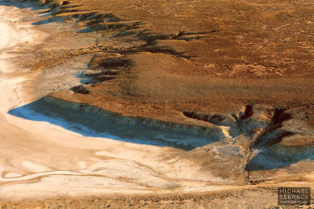 The old shoreline of Lake Eyre, eroded over aeons of millennia, during scarce heavy rainfall and floods.<br /> <br /> Code: LASE0001<br /> <br /> Open Edition Print / Stock Image