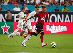 July 31, 2018 - Miami Gardens, Florida, USA - Manchester United F.C. midfielder Andreas Pereira (15) drives the ball past Real Madrid C.F. midfielder Marcos Llorente (18) during an International Champions Cup match between Real Madrid C.F. and Manchester United F.C. at the Hard Rock Stadium in Miami Gardens, Florida. Manchester United F.C. won the game 2-1. (Credit Image: © Mario Houben via ZUMA Wire)