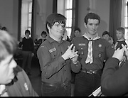 Scout Inducted Using Sign Language.   (P6)..1981..08.12.1981..12.08.1981..8th December 1981..Joe Needham, a deaf and dumb resident in Stewart's Hospital, Palmerstown, Co Dublin was enrolled into the 43rd Dublin (Palmerstown) unit of the Scouting Association of Ireland. The Chief Scout, Mr Joe McGough carried out the enrollment at the hospital. Ms Domenica Malocca, a teacher in the class for the deaf at the hospital, translated the Scout Promise into sign language during the ceremony...Using sign language, Joe Needham, was pictured taking the Scout Pledge at the ceremony in Stewart's Hospital.