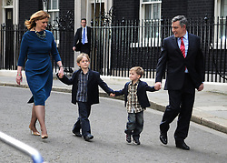 © under license to London News Pictures. LONDON. 05/05/2011. One year on since the last General Election. FILE PICTURE DATED.11/05/10. Gordon Brown, his wife Sarah, children John and James walk along Downing Street to a waiting car on the evening of Gordon Brown's resignation as Prime Minister. British Prime Minister Gordon Brown has resigned his position and David Cameron has become the new British Prime Minister on May 11, 2010. The Conservative and Liberal Democrats are to form a coalition government after five days of negotiation. Photo credit should read Stephen Simpson/LNP