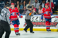 KELOWNA, BC - JANUARY 31: Referee Chris Crich calls an interference penalty on Leif Mattson #28 of the Spokane Chiefs during first period against the Kelowna Rockets at Prospera Place on January 31, 2020 in Kelowna, Canada. (Photo by Marissa Baecker/Shoot the Breeze)