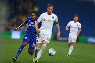 Pontus Jansson of Leeds Utd in action © as Nathaniel Mendez-Laing of Cardiff city (l) challenges. .EFL Skybet championship match, Cardiff city v Leeds Utd at the Cardiff city stadium in Cardiff, South Wales on Tuesday 26th September 2017.<br /> pic by Andrew Orchard, Andrew Orchard sports photography.