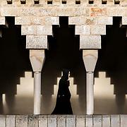 A young monk walks under the arcades of the main cloister to reach the refectory. 09-01-16<br /> Un jeune moine marche sous les arcades du grand cloître pour rejoindre le réfectoire. 09-01-16