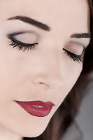 Closeup portrait of a beautiful caucasian woman eyes closed and red lips