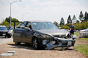 A VTA bus and car collided during an accident on the first day of school on Escuela Parkway near Thomas Russell Middle School in Milpitas, California, on August 19, 2013. (Stan Olszewski/SOSKIphoto)