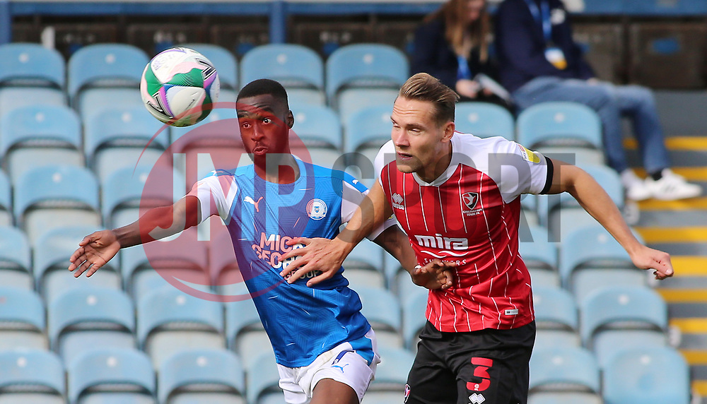 Mohamed Eisa of Peterborough United battles with Chris Hussey of Cheltenham Town - Mandatory by-line: Joe Dent/JMP - 05/09/2020 - FOOTBALL - Weston Homes Stadium - Peterborough, England - Peterborough United v Cheltenham Town - Carabao Cup