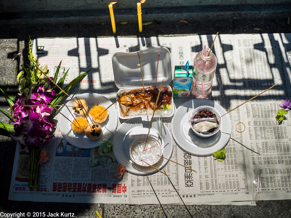 19 AUGUST 2015 - BANGKOK, THAILAND: Food left as an offering for people who died in the terror bombing at Erawan Shrine. Erawan Shrine in Bangkok reopened Wednesday morning after more than 20 people were killed and more than 100 injured in a bombing at the shrine Monday, August 17, 2015. The shrine is a popular tourist attraction in the center of Bangkok's high end shopping district and is an important religious site for Thais. No one has claimed responsibility for the bombing.      PHOTO BY JACK KURTZ