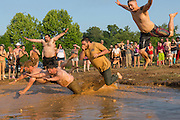 Competitor belly flop into a muddy watering hole during the dive competition at the 2015 National Red Neck Championships May 2, 2015 in Augusta, Georgia. Hundreds of people joined in a day of country sport and activities.