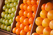 Farmers Market, oranges and fruit in boxes on display