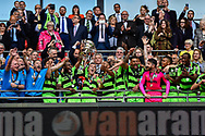 Forest Green Rovers lift the ply off final trophy and celebrate promotion in to the football league Forest Green Rovers Liam Noble(15) during the Vanarama National League Play Off Final match between Tranmere Rovers and Forest Green Rovers at Wembley Stadium, London, England on 14 May 2017. Photo by Adam Rivers.