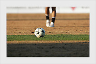 Opening match of the Finnish premier league, 2004. Groundsman applied a wrong fertilizer, killing the grass. One patch the length of the pitch was left accidentally untouched, showing what could have been. Vantaa, May 6, 2004.