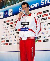 08.12.2011, Stettin, POL, Kurzbahn Schwimm EM, Podium 200m Lagen, im Bild Markus ROGAN (AUT, Silber Medaille) // Markus ROGAN of Austria silver medal on Podium 200m Individual at European Swimming Short Course Championships 2011, Szczecin, Poland on 2011/12/08. EXPA Pictures © 2011, PhotoCredit: EXPA/ Insidefoto/ Giorgio Scala..***** ATTENTION - for AUT, SLO, CRO, SRB, SUI and SWE only *****
