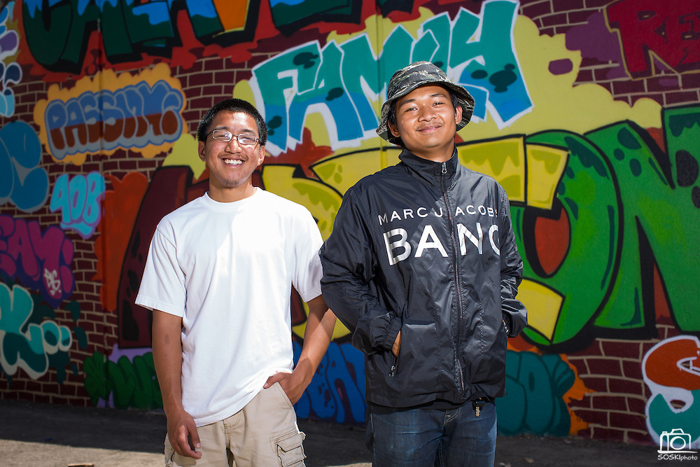Calaveras Hills High School seniors, Gerald Ilagan, left, and Girvin Sobrevilla, pose for a portrait with their senior mural, which took more than 7 months to spray paint, at Calaveras Hills High School in Milpitas, California, on June 10, 2014.  The mural was composed with inspirational words and other ideas from classmates. (Stan Olszewski/SOSKIphoto)