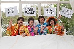 "IMAGE EMBARGOED UNTIL FRIDAY, 17 MAY 2013, 9am BST. © Licensed to London News Pictures. 16/05/2013. London, England. The cast of the Beatles show LET IT BE staged a recreation of the famous 'bed-in' scene (originally with John Lennon and Yoko Ono) in full ""Sgt Pepper"" costumes in a room at the Savoy Hotel to coincide with the announcement of the extension of the run at the Savoy Theatre to 18 January 2014. L-R: Reuven Gershon as John Lennon, Luke Roberts as Ringo Starr, Emanuele Angeletti as Paul McCartney and Stephen Hill as George Harrison. Photo credit: Bettina Strenske/LNP"
