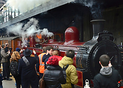 © Licensed to London News Pictures. 13/01/2013. London, UK Crowds at Earls Court Underground station as it welcomes the newly restored Met steam Locomotive No. 1 back to the Underground today, 13th January 2013, on the original stretch of the Metropolitan line. This is to mark the 150th anniversary of the opening of the world's first underground in January 1863. The Metropolitan Railway 'Jubilee' Carriage No. 353, recently restored by the Ffestioniog Railway. The Chesham set of Metropolitan Railway Bogie stock coaches (1898-1900), the Metropolitan Railway Milk Van No. 3 (1896) were all pulled by Met No 1 (built 1898) which provided the motive power at the front of the train. Photo credit : Stephen Simpson/LNP