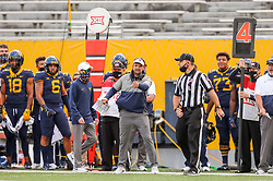 Oct 3, 2020; Morgantown, West Virginia, USA; West Virginia Mountaineers head coach Neal Brown argues a call during the fourth quarter against the Baylor Bears at Mountaineer Field at Milan Puskar Stadium. Mandatory Credit: Ben Queen-USA TODAY Sports