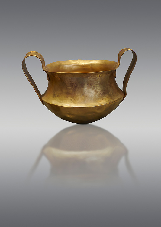Two handled Mycenaean gold bowl cup from the Kakovatos tholos tomb, Trifylia, Greece. National Archaeological Museum Athens.  Grey Background<br /> <br /> Kakovatos is a significant site of the early Mycenaean period of Greece (c. 16th to 15th century BC) on the west coast of the Peloponnese (Zacharo, Nomos Elis) and became widely known through the excavations of three large tholos tombs by Wilhelm Dörpfeld in 1907–1908. .<br /> <br /> If you prefer to buy from our ALAMY PHOTO LIBRARY  Collection visit : https://www.alamy.com/portfolio/paul-williams-funkystock/mycenaean-art-artefacts.html . Type -   Athens    - into the LOWER SEARCH WITHIN GALLERY box. Refine search by adding background colour, place, museum etc<br /> <br /> Visit our MYCENAEN ART PHOTO COLLECTIONS for more photos to download  as wall art prints https://funkystock.photoshelter.com/gallery-collection/Pictures-Images-of-Ancient-Mycenaean-Art-Artefacts-Archaeology-Sites/C0000xRC5WLQcbhQ