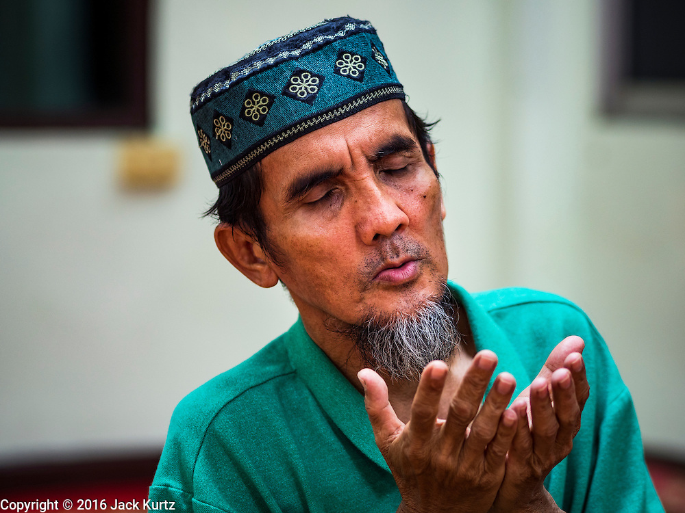 05 JUNE 2016 - BANGKOK, THAILAND:  A man prays at Masjid Darul Faha, a small mosque in the Muslim majority neighborhood of Ban Krua in Bangkok on the night before the start of Ramadan. Ramadan is the ninth month of the Islamic calendar, and starts on June 6 this year. It is observed by Muslims worldwide as a month of fasting to commemorate the first revelation of the Quran to Muhammad according to Islamic belief. This annual observance is regarded as one of the Five Pillars of Islam. Islam is the second largest religion in Thailand.      PHOTO BY JACK KURTZ