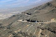 Car driving on unsurfaced road, Atlantic Ocean coast, Jandia peninsula, Fuerteventura, Canary Islands, Spain