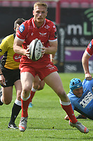 Rugby Union - 2021 Guinness Pro14 Rainbow Cup - Northern Section - Scarlets vs Cardiff Blues - Parc-y-Scarlets<br /> <br /> Johnny McNicholl Scarlets attacks with the ball in two hands<br /> <br /> <br /> COLORSPORT/WINSTON BYNORTH