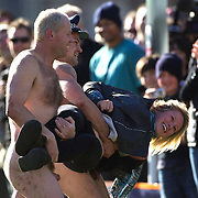 A 'clothed' streaker is removed from the field during the 'Nude Blacks' versus a Fijian invitation side played at Logan Park, Dunedin as an unofficial curtain raiser match before the New Zealand V Fiji test match in Dunedin, New Zealand...The 'Nude Blacks' won the match 20-10 with 21 year old female player Rachel Scott, a member of the Otago women's rugby team named player of the day. .Over 500 people turned up to watch the match which included a blind referee, Julie Woods and three clothed streakers who were ejected from the playing area..The 'Nude Blacks' traditionally play games before test matches in Dunedin and were using this match as a warm up for three nude games planned during the IRB Rugby World Cup in New Zealand with teams from Argentina, Italy, England and Ireland involved.  Matches will be played before World Cup games in Dunedin. New Zealand. 22nd July 2011. Photo Tim Clayton