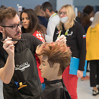 Participant competes in hair styling during the EuroSkills European Championship of young professionals in Budapest, Hungary on Sept. 26, 2018. ATTILA VOLGYI