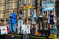 London, UK. 20 September, 2019. Students holding handmade signs take part in the second Global Climate Strike.
