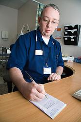 Nurse prescribing medication for patient attending the NHS Walk in Centre; Nottingham,