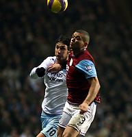 Photo: Mark Stephenson/Sportsbeat Images.<br /> Aston Villa v Manchester City. The FA Barclays Premiership. 22/12/2007.Villa's Wilfred Bouma beats Rolando Bianchi to the ball